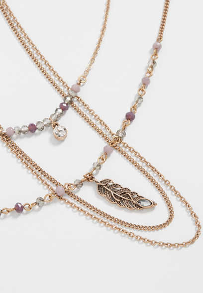 purple bead and feather three piece necklace set