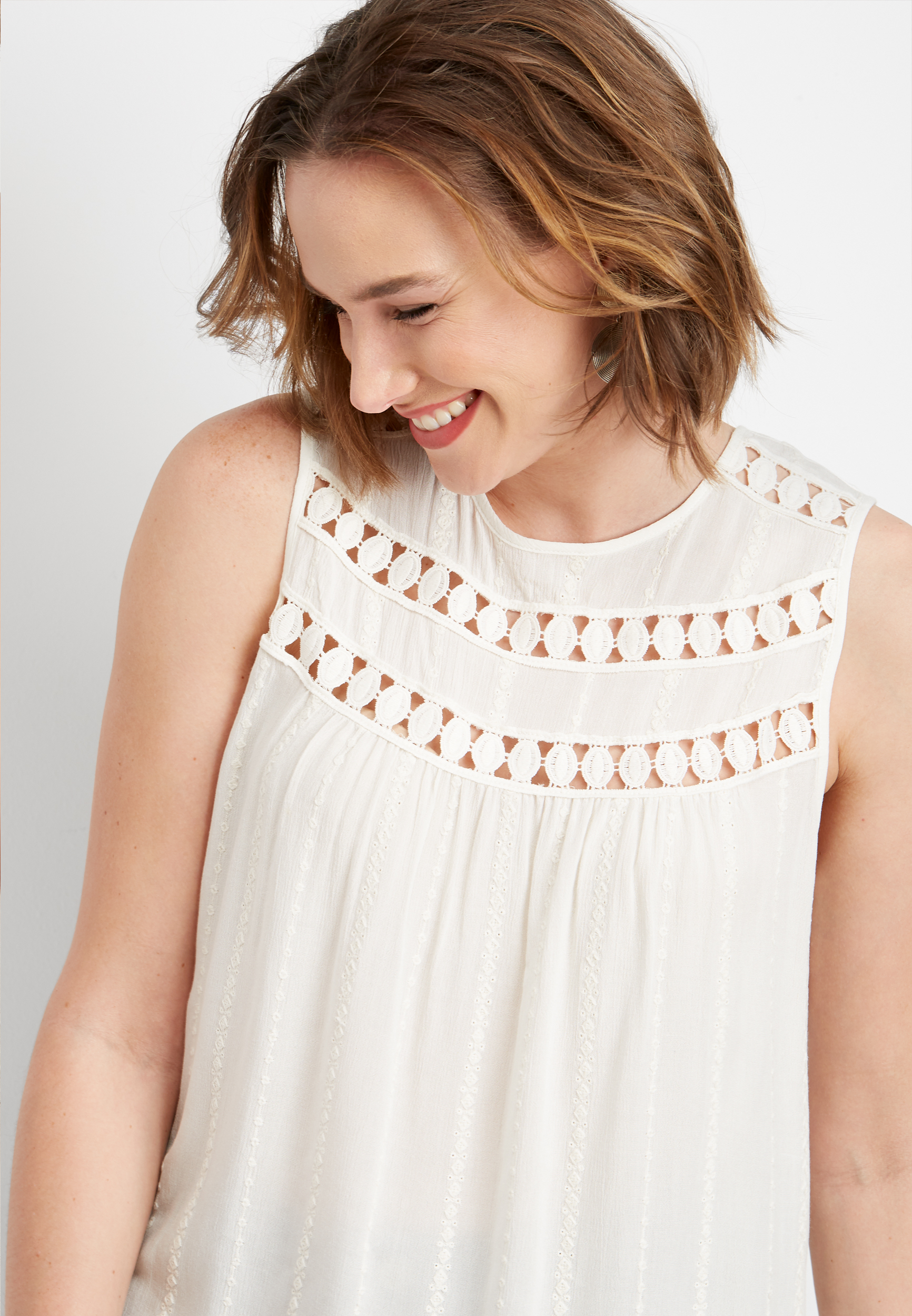 Solid Embroidered Crew Neck Tank by Maurices