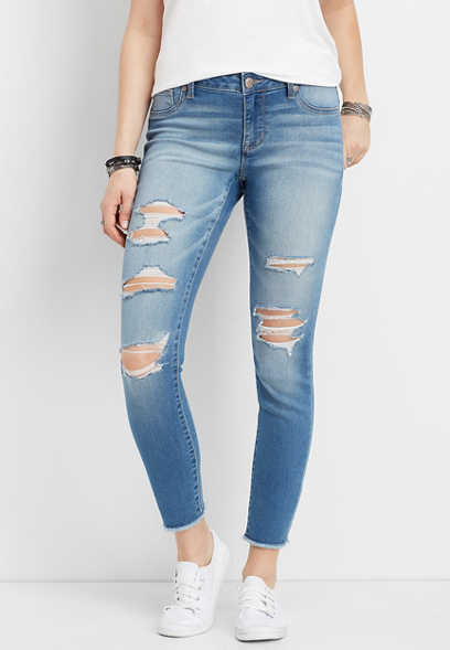 DenimFlex™ medium wash destructed fray hem cropped jegging
