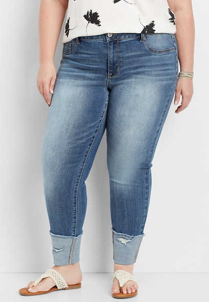 plus size DenimFlex™ medium wash destructed cuff jegging