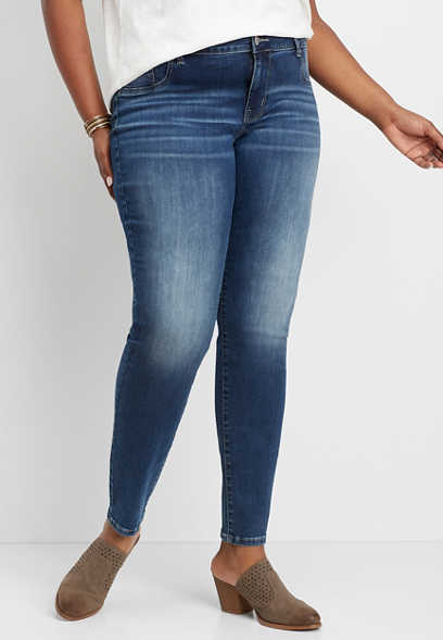 plus size medium wash jegging made with REPREVE®