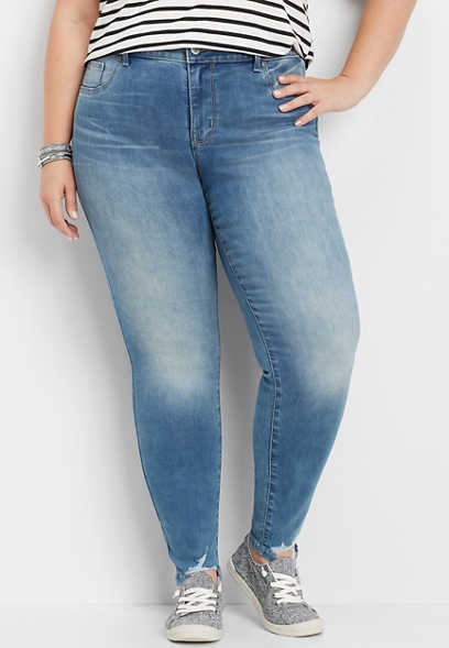 plus size medium wash shredded hem jegging made with REPREVE®