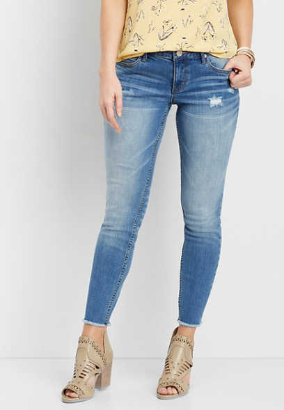 skinny ankle jeans with frayed bottom hem and destruction